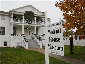 The Wolcott House dons its gay apparel for holiday visitors.
