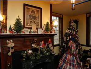 The Judge's office is decorated for Christmas. Above the mantel is a print of the St. Nicholas from