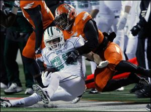 Ohio University's Matt Waters is brought down by BGSU's Jerry