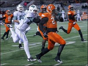 Ohio University's Matt Waters tackles defensive back Jerry