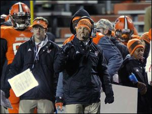 BGSU head football coach Dave Clawson is active on the sideline.