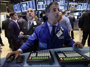 Trader John Liotti, left, and specialist Anthony Rinaldi work on the floor of the New York Stock Exchange today.