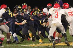 Whiteford senior Colin Lake runs against Detroit Allen. Lake leads the Bobcats with 686 yards rushing on 109 carries.