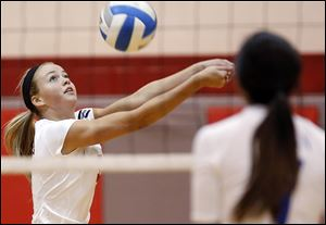Bedford's Nicole Rightnowar returns a serve against  Adrian. Rightnowar has 486 kills and 175 blocks.