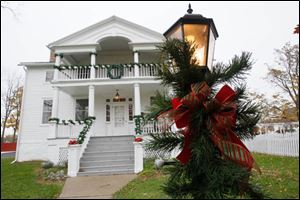 The Wolcott House dons its gay apparel for holiday visitors at the historic home in Maumee.