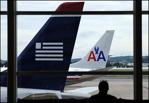 The agreement to allow American Airlines and US Airways to merge requires them to give up takeoff and landing rights to low-cost carriers at a number of airports to ensure more competition.