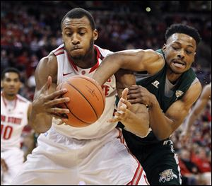 Ohio State's Trey McDonald, left, and Ohio University's T.J. Hall go for a rebound during the first half.