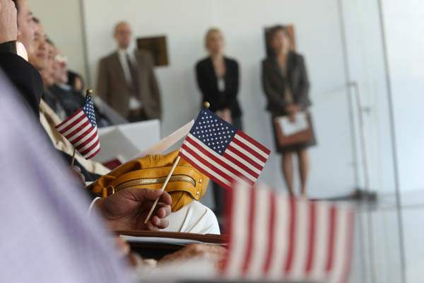 New-citizens-wave-their-American-flags