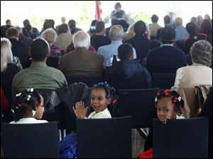 citizens13 Miyonnah Gordon, 5, left, Serinity, 3, center, and Mariah, 5, right, sit together during the Wednesday, Nov. 13, 2013, naturalization ceremony at the Toledo Museum of Art Glass Pavilion. Thirty eight new citizens, including the girls' mother Kymaeh Brisbane Gordon, were sworn in during the ceremony.  THE BLADE/KATIE RAUSCH