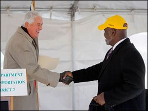 Ohio Department of Transportation Director Jerry Wray, left, shakes hands with Toledo Mayor Mike Bell.