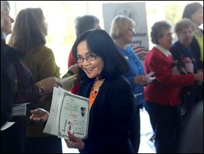 Teresita Castillo Badman, center, smiled as she received her documentation of citizenship after bring sworn in.