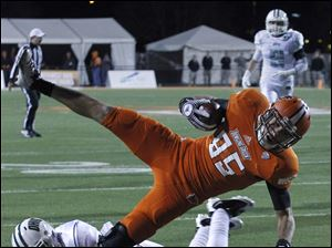 BGSU's Heath Jackson is brought down short of the goal line by Ohio University's Xavier Hughes.