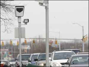 Toledo has been using red-light cameras since 2001 and wants to prevent a state ban on their use.