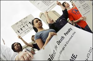 In this 2007 file photo, people rally at the Ohio Statehouse to oppose the death penalty.