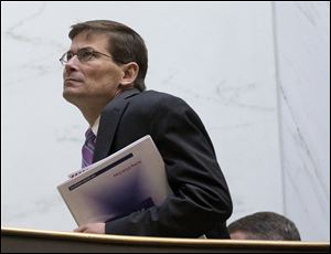Then-acting CIA Director Michael Morell walks in the hallway of the Capitol Hill in Washington in November, 2012.
