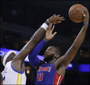 Detroit Pistons' Greg Monroe, right, shoots over Golden State Warriors' Jermaine O'Neal.