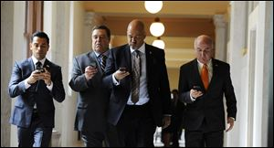 From left, Mark Consuelos, John Goodman, Clark Johnson, and Matt Malloy star in 'Alpha House,' which debuts Friday on Amazon.com.