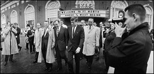 This Nov. 22, 1963, file photo shows President John F. Kennedy, center, and Vice President Lyndon Johnson, in light-colored coat behind Mr. Kennedy, in Fort Worth, from where they left for Dallas.