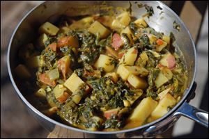 Curried Spinach and Red Potatoes is a quick and easy curry that stands on its own. It can also be served over jasmine rice or with your favorite protein.