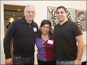 Labib, left, and Karyn Hajjar and their son at the Science Society event at the home of Allan and Susan Allan Block.