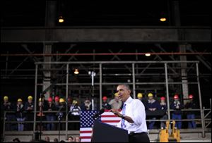 President Barack Obama speaks today at ArcelorMittal, a steel mill in Cleveland.