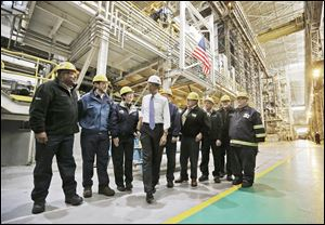 President Obama talks with workers at ArcelorMittal Cleveland, a steel mill he visited to discuss the economy and manufacturing. From there he headed to Philadelphia for Democratic fund-raisers.