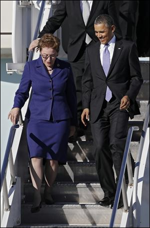 President Barack Obama, accompanied by Rep. Marcy Kaptur, D-Ohio, exit Air Force One today at Cleveland Hopkins International Airport.