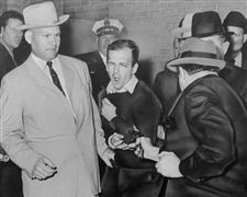 Handcuffed-To-Oswald