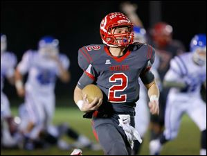 Bedford quarterback Brad Boss (2) runs for a touchdown on fourth and 2 against Detroit Catholic Central.