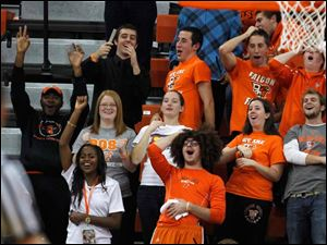 Fans react to another fan's attempt during a time-out foul shot contest on the court at the Stroh Center.