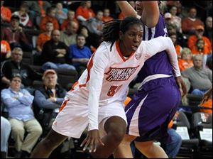 BGSU's Alexis Rogers dribbles around Niagara's Victoria Rampado during a game at the Stroh Center.