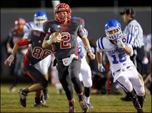 Bedford High School quarterback Brad Boss takes off on a 96-yard run against Detroit Catholic Central in the third quarter.