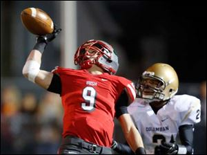 Central Catholic's Ryan O'Hearn (9) bats down a pass intended for Tiffin Columbian's Cody Kimmet (2).