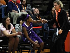 Niagara's Tiffany Corselli is helped off the floor by BGSU head coach Jennifer Roos during the second half.