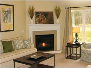 A cozy fireplace and large windows make this great room an inviting place to be.