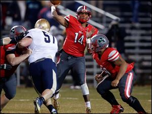 Central Catholic quarterback DeShone Kizer (14) throws the ball against Tiffin Columbian.