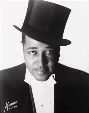 Duke Ellington, composer, orchestra leader, and jazz pianist, is seen in a publicity photograph of 1933. Ellington was born April 29, 1899, and died in 1974.
