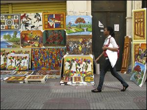 Calle El Conde is a pedestrian walkway where seemingly everything is for sale, including art, in Santo Domingo, Dominican Republic.