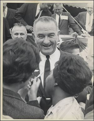 Lyndon Johnson visited with a crowd in Toledo in late September, 1963. After becoming president two months later, Mr. Johnson said, 'I want to come down very hard on civil rights, not because Kennedy was for it but because I am for it.'