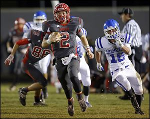 Bedford quarterback Brad Boss takes off on a 96-yard run against Detroit Catholic Central.