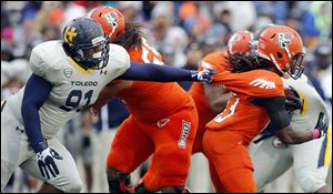 Toledo nose tackle Treyvon Hester grabs Bowling Green's Travis Greene. Hester, a freshman, has registered six tackles for losses and 3½ sacks for the Rockets this season.