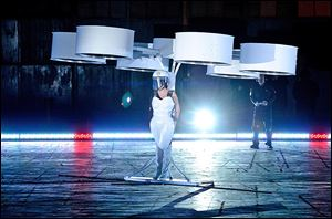 Lady Gaga demonstrates the Volantis transport prototype 'flying dress' designed by TechHaus - Studio XO during the 'Artpop' album release and artRave event in New York.