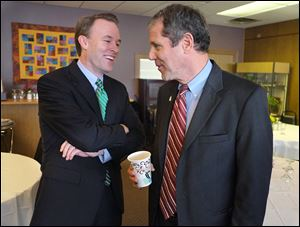 Ed FitzGerald, Cuyahoga County executive and Democratic candidate for governor, left, and U.S. Sen. Sherrod Brown (D., Ohio), chat after Mr. Brown endorsed him during a visit to Toledo.