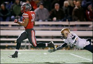 Central running back Tre'Von Wade gets past Tiffin Columbian's Jeffrey Crawford on a TD run.
