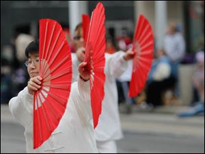 Lingling Du, a member of the Chinese Association of Greater Toledo, with a demonstration of Tai Chi during the parade.