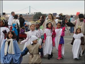 Members of Girl Scout Troop 10392 in the parade.