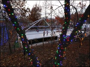 Skaters try out the new ice rink before a ceremony kicking off Lights Before Christmas.