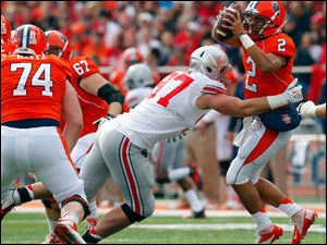Illinois quarterback Nathan Scheelhaase (2) is sacked by Ohio State defensive lineman Joey Bosa (97) during the first half.