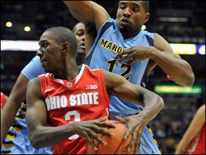 Ohio State's' Shannon Scott drives around Marquette's 's Derrick Wilson during the second half.