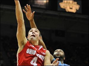 Ohio State's' Aaron Craft (4) drives to the basket around Marquette's 's Davante Gardner (54) during the second half.